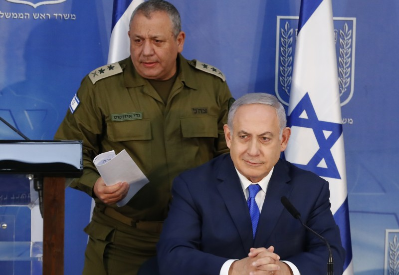 Benjamin Netanyahu and Israeli Chief of Staff Gadi Eizenkot give a press conference in Tel Aviv, on Dec. 4, 2018. (Jack Guez/AFP/Getty Images)