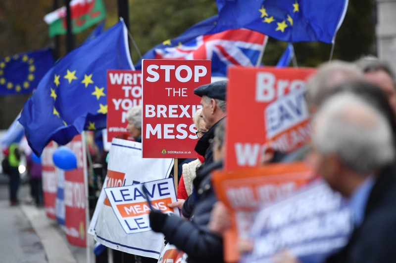 Demonstrators for and against Brexit protest opposite the Houses of Parliament in London on December 5, 2018.  (BEN STANSALL/AFP/Getty Images)