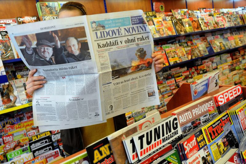 A man reads Czech newspaper Lidove Noviny in a shop in Prague on March 21, 2011. (Michal Cizek/AFP/Getty Images)