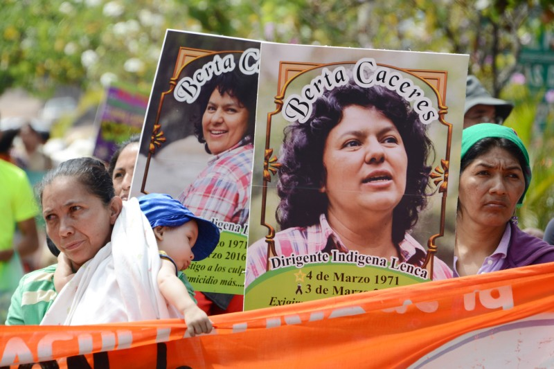 Posters depicting slain Honduran environmentalist Berta Cáceres are carried during an International Women's day demonstration in Tegucigalpa on March 8, 2016. (Orlando Sierra/AFP/Getty Images)