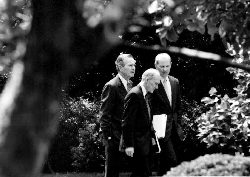 George Bush speaks with Brent Scowcroft and James Baker at the White House on May, 19 1992 (J. David Ake/AFP/Getty Images)