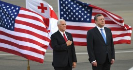 U.S. Vice President Mike Pence, left, and then-Georgian Prime Minister Giorgi Kvirikashvili attend a welcoming ceremony at the airport in Tbilisi, Georgia, on July 31, 2017. (Vano Shlamov/AFP/Getty Images)
