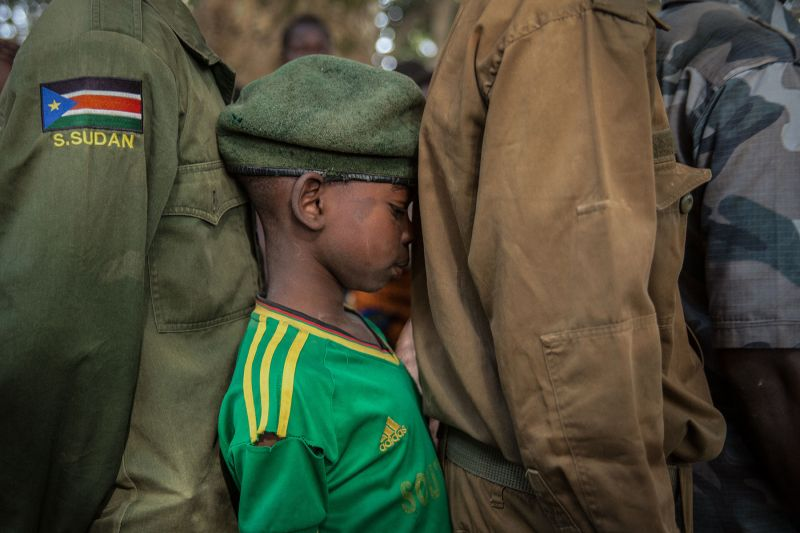 Newly released child soldiers wait in a line for their registration during the release ceremony in Yambio, South Sudan, on February 7, 2018.(STEFANIE GLINSKI/AFP/Getty Images)
