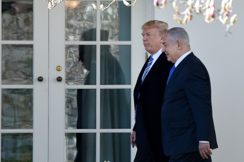 U.S. President Donald Trump and Israel's Prime Minister Benjamin Netanyahu walk outside the Oval Office of the White House on March 5. (Olivier Douliery-Pool/Getty Images)