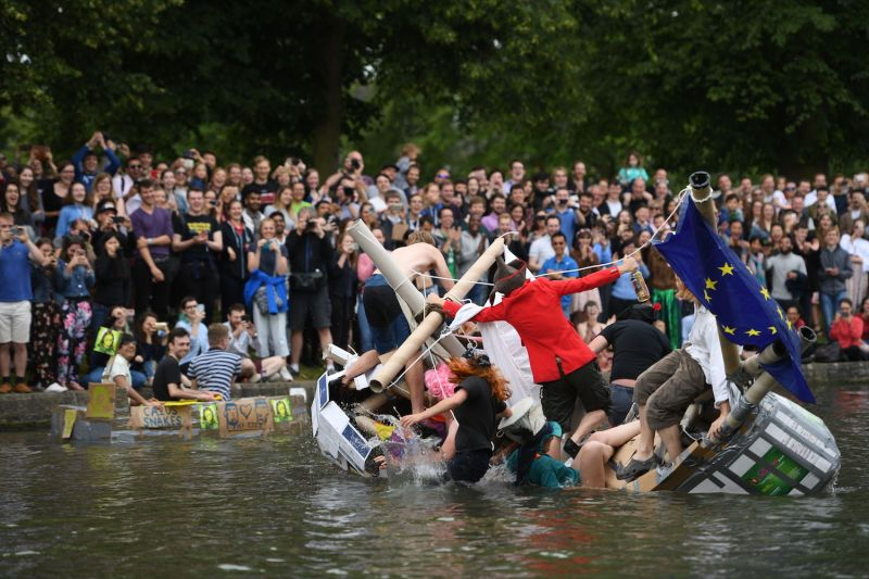 Cambridge University students float down the River Cam in cardboard boats, part of the annual traditions to celebrate the end of exams, in Cambridgeshire, United Kingdom, on Jun. 17. (Joe Giddens/PA Images/Getty Images)