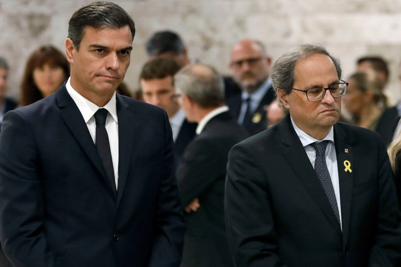 Spanish prime minister Pedro Sánchez (L) and Catalan regional president Joaquim Torra at the funeral of Spanish opera singer Montserrat Caballe in Barcelona on Oct. 8, 2018.