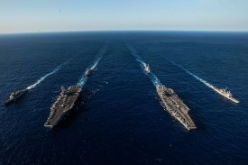 U.S. Navy ships attached to the Ronald Reagan and John C. Stennis carrier strike groups transit the Philippine Sea during dual carrier operations on Nov. 18, 2018. (Mass Communication Specialist 2nd Class Kaila V. Peters/U.S. Navy)