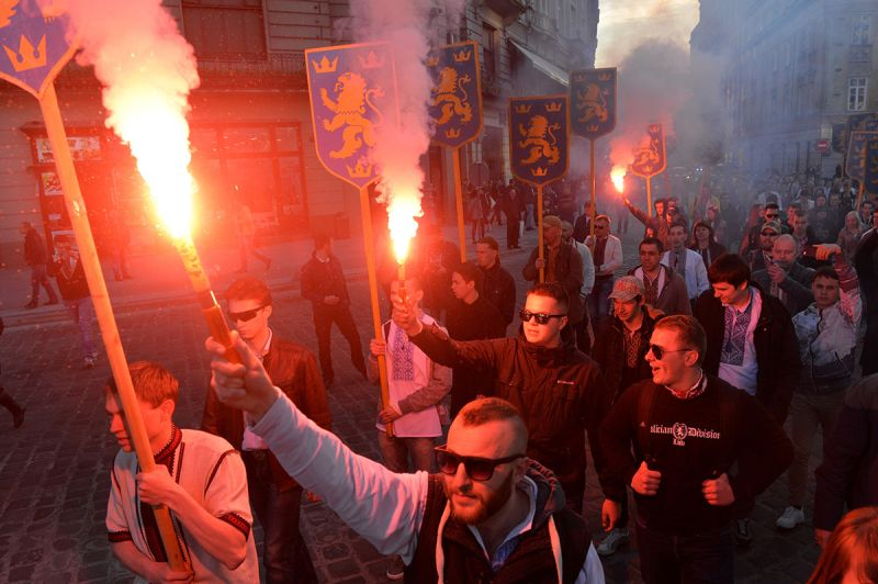 Ukrainian ultra-nationalists burn flares and shout slogans as they march in the center of Lviv on April 28, 2016, to mark the 73rd anniversary of the foundation of the SS Galicia. (Yuriy Dyachshyn/AFP/Getty Images)