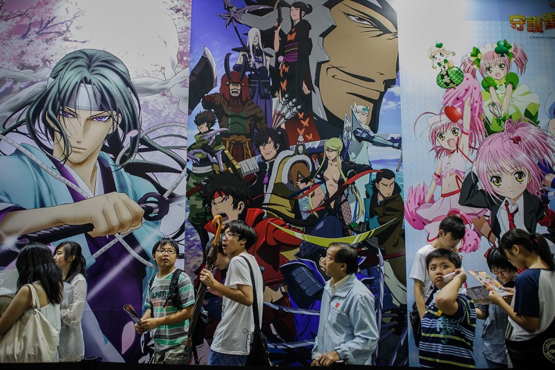 Visitors line up in front of billboards showing anime characters during the 14th Ani-Com and Games exhibition in Hong Kong on July 27, 2012.  (Philippe Lopez/AFP/GettyImages)