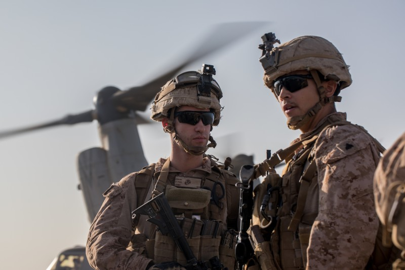 U.S. Marines with 3d Battalion, 7th Marine Regiment, attached to Special Purpose Marine Air-Ground Task Force, Crisis Response-Central Command, prepare to board an MV-22 Osprey on to a site near At-Tanf Garrison, Syria, on Sept. 7, 2018. (U.S. Marine Corps photo by Cpl. Carlos Lopez)