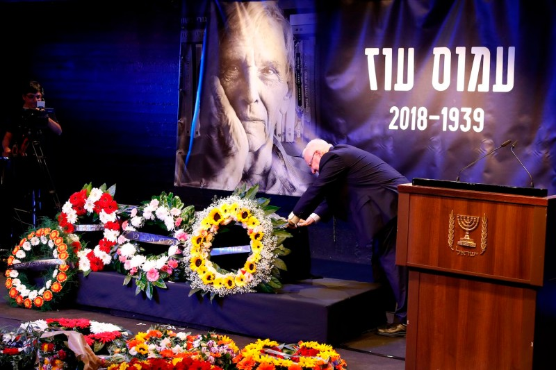 Israeli President Reuven Rivlin mourns over the coffin of Israeli writer Amos Oz during a memorial service on Dec. 31, 2018, in Tel Aviv. (Jack Guez/AFP/Getty Images)