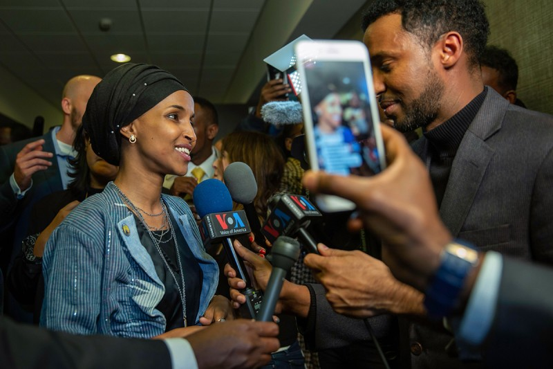 Ilhan Omar (L), newly elected to the U.S. House of Representatives on the Democratic ticket, speaks to the medias in Minneapolis, Minnesota on November 6, 2018. - US voters elected two Muslim women, both Democrats, to Congress on November 6, 2018, marking a historic first in a country where anti-Muslim rhetoric has been on the rise, American networks reported. Ilhan Omar, a Somali refugee, won a House seat in a heavily-Democratic district in the Midwestern state of Minnesota, where she will succeed Keith Ellison, himself the first Muslim elected to Congress. (Photo by Kerem Yucel / AFP)        (Photo credit should read KEREM YUCEL/AFP/Getty Images)