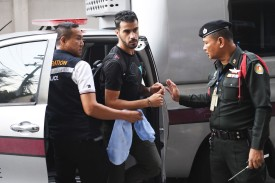 Hakeem al-Araibi, a former Bahrain national team soccer player with refugee status in Australia, is escorted by immigration police to a court in Bangkok on Dec. 11, 2018.