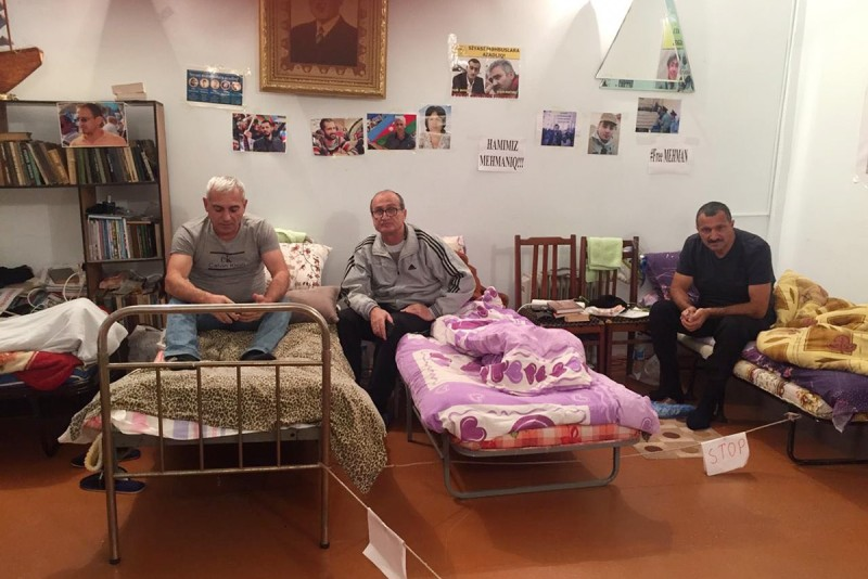 From left, Rafik Bakhishov, Zafar Ahmadov, and Tofig Yagublu take part in a hunger strike at the headquarters of the opposition party Musavat in Baku, Azerbaijan, on Jan. 15. (Khadija Ismayilova)