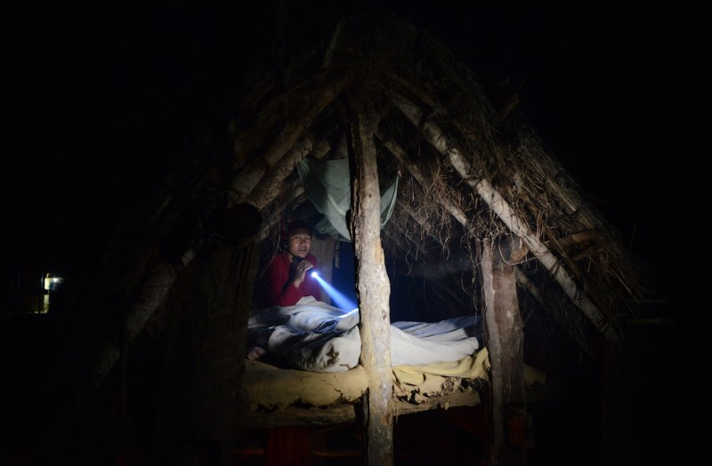A Nepalese woman prepares to sleep in a chhaupadi hut during her period in Surkhet District, 300 miles west of Kathmandu. Feb. 3, 2017.