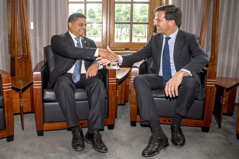 Dutch Prime Minister Mark Rutte (R) shakes hands with Curacao Prime Minister Eugen Rhuggenaarh (L) ahead of a meeting in The Hague on June 30, 2017.