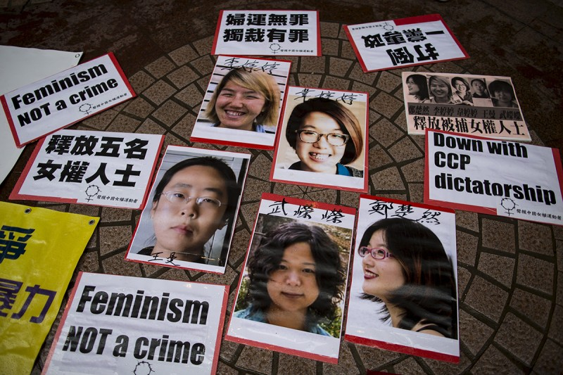 Portraits of Li Tingting, Wei Tingting, Wang Man, Wu Rongrong, and Zheng Churan—who became known as the Feminist Five—during a protest calling for their release in Hong Kong on April 11, 2015. (Tyrone Siu/Reuters)