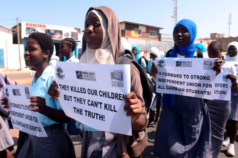 Demonstrators during a march commemorating victims of Gambia's former regime, in Serekunda, on April 10, 2017.