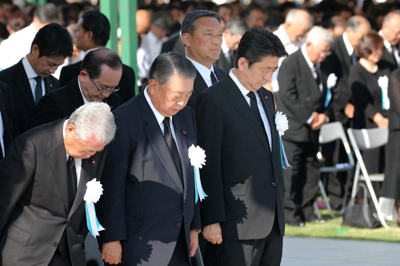 Japanese Prime Minister Shinzo Abe (left) offers a silent prayer during the 73rd anniversary memorial service for the atomic bomb victims at Hiroshima Peace Memorial Park on Aug. 6, 2018. (JIJI PRESS/AFP/Getty Images)