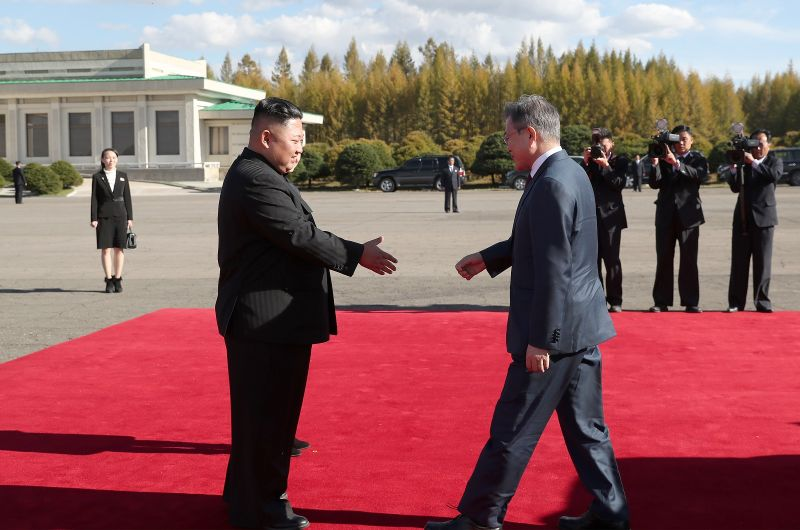 North Korea's leader Kim Jong Un (L) bids farewell to South Korean President Moon Jae-in (R) on Moon's departure from North Korea at Samjiyon airport on September 20, 2018 in Samjiyon, North Korea. (Photo by Pyeongyang Press Corps/Pool/Getty Images)