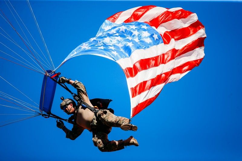 A skydiver with the American flag in tow in Kansas City, Missouri, on Sept. 23, 2018. (David Eulitt/Getty Images)