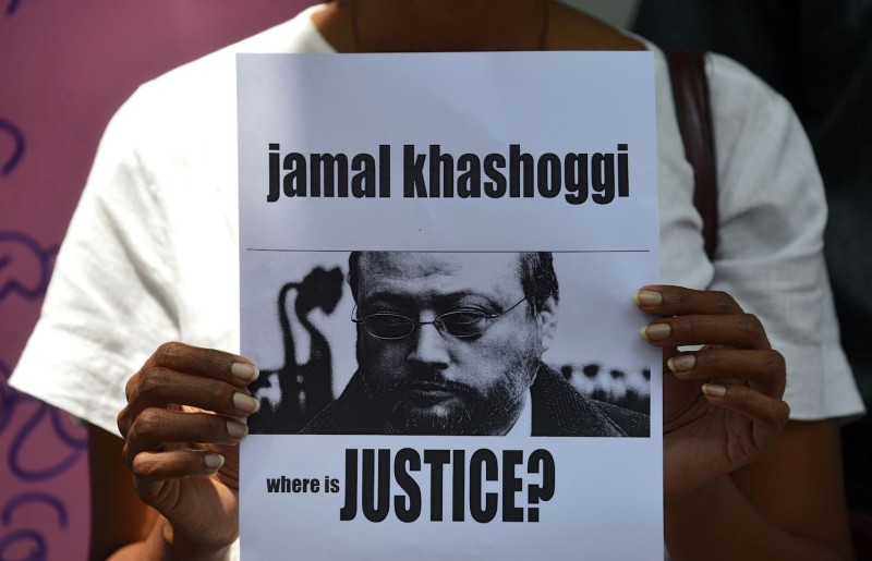 A protester holds a placard with the image of the Saudi journalist Jamal Khashoggi during a demonstration outside the Saudi Embassy in Colombo, Sri Lanka, on Oct. 25, 2018. (Lakruwan  Wanniarachichi/AFP/Getty Images)