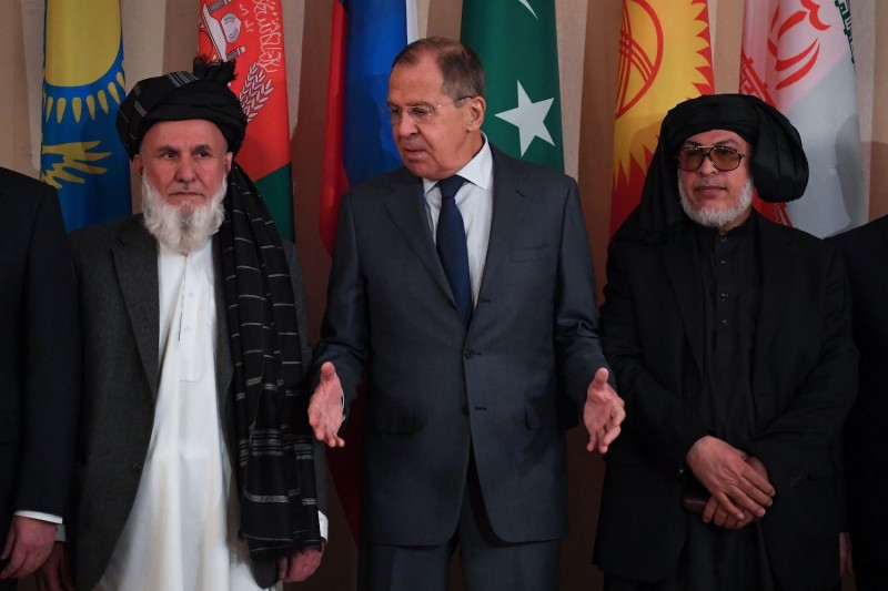 Russian Foreign Minister Sergei Lavrov and representatives of both the Afghan government and the Taliban pose for a photo prior to international talks on Afghanistan in Moscow on Nov. 9, 2018. (Yuri Kadobnov/AFP/Getty Images)