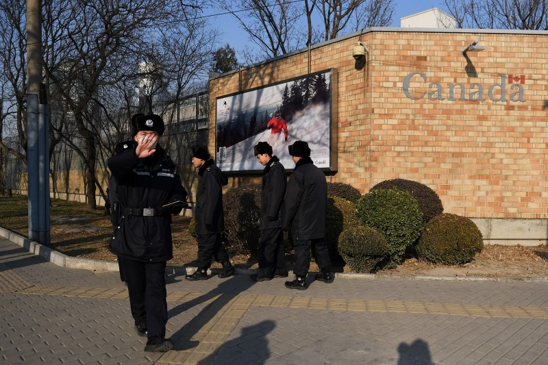 Chinese police patrol in front of the Canadian embassy in Beijing on December 14, 2018. (GREG BAKER/AFP/Getty Images)