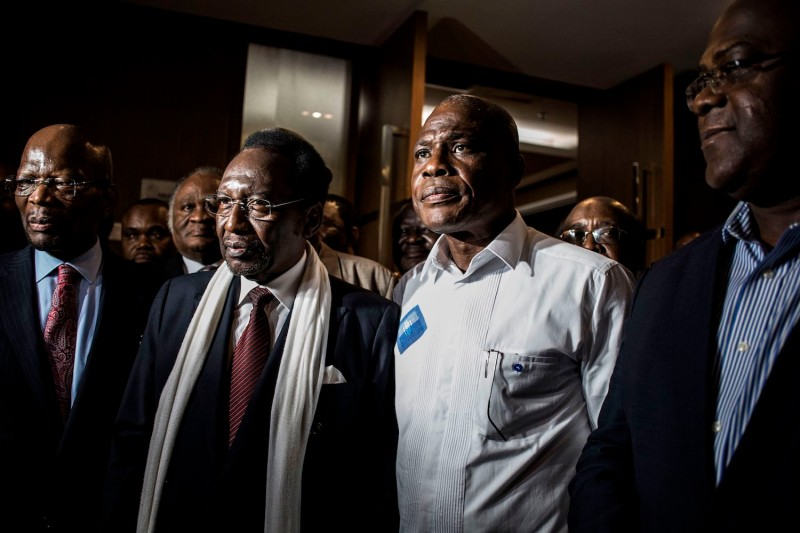 Opposition candidates Felix Tshisekedi (right), Martin Fayulu (second from right), and the head of the African Union Election Observation Mission, former interim Malian President Dioncounda Traoré (second from left), leave after a joint meeting on Jan. 2 in Kinshasa. (John Wessels/AFP/Getty Images)