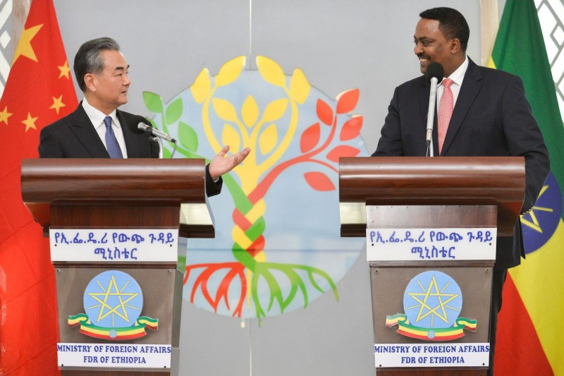 Chinese Foreign Minister Wang Yi and Ethiopian Foreign Minister Workneh Gebeyehu speak during a joint press conference in Addis Ababa, Ethiopia, on Jan. 3, during Wang's official visit. (Michael Tewelde/AFP/Getty Images)