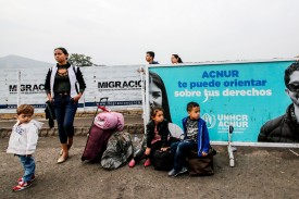 A Venezuelan family at the Simon Bolivar International Bridge in the Colombian border city of Cucuta on January 10. (Schneyder Mendoza/AFP/Getty Images)