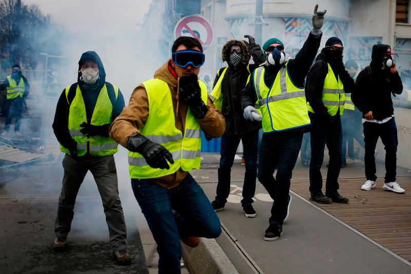Yellow Vest protesters clash with police during an anti-government demonstration on Jan. 12 in Caen, France. (Charly Triballeau/AFP/Getty Images)