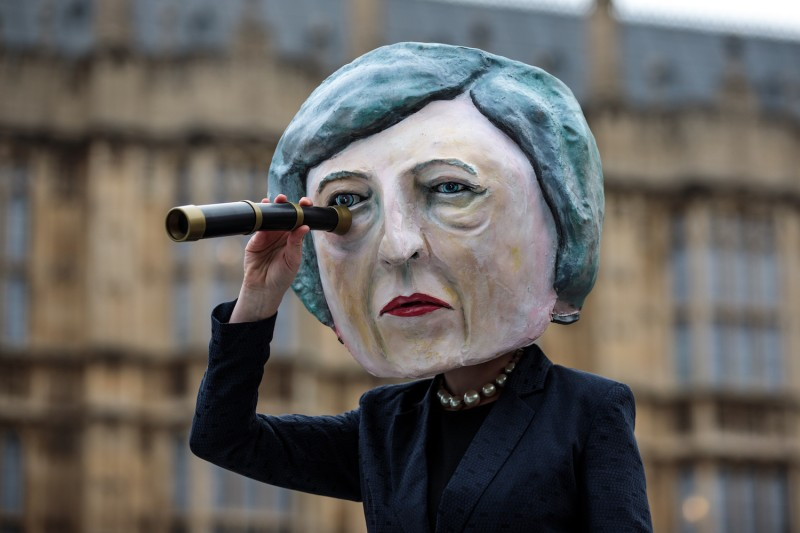 A demonstration featuring a papier-mâché Theresa May head outside the Houses of Parliament in London on Jan. 15. (Jack Taylor/Getty Images)
