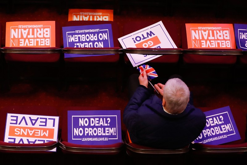 "Attendees take their seats at a political rally titled ""Let's Go WTO,"" hosted by the pro-Brexit lobby group Leave Means Leave in London on Jan. 17. (Tolga Akmen/AFP/Getty Images)"