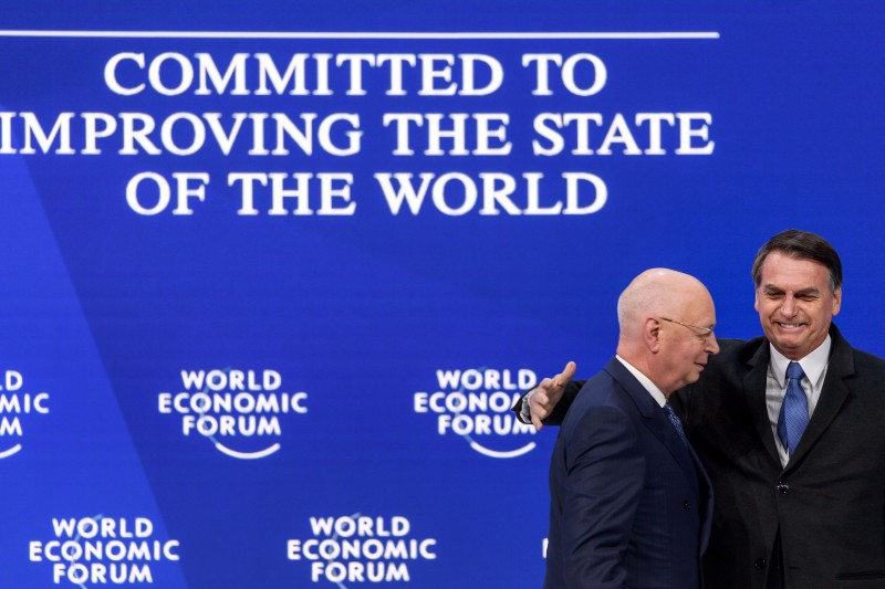 Brazilian President Jair Bolsonaro and Executive Chairman of the World Economic Forum Klaus Schwab at the World Economic Forum on Jan. 22, 2019 in Davos, Switzerland. (Fabrice Coferini/AFP/Getty Images)