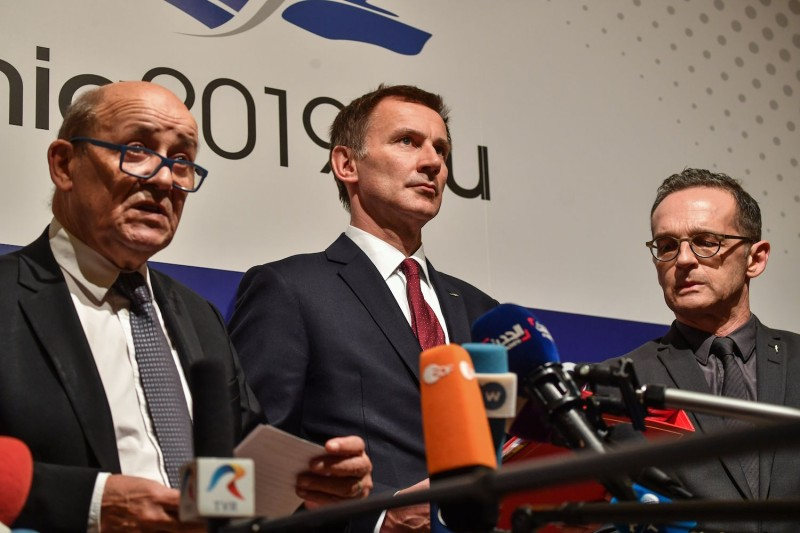From left, French Foreign Minister Jean-Yves Le Drian, U.K. Foreign Secretary Jeremy Hunt, and German Foreign Minister Heiko Maas launch the long-awaited special vehicle for Iran trade in Bucharest, Romania, on Jan. 31. (Daniel Mihailescu/AFP/Getty Images)