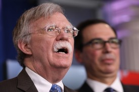 U.S. National Security Advisor John Bolton and Treasury Secretary Steven Mnuchin hold a press briefing at the White House on Jan. 28. (Win McNamee/Getty Images)