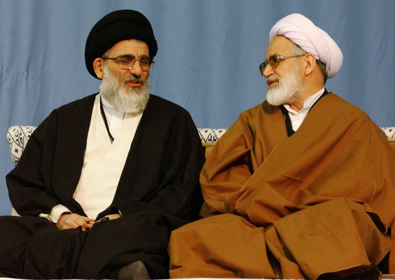 Iranian reformist Parliament Speaker Mehdi Karroubi, at right, speaks with hardline Judiciary Chief Mahmood Shahroudi in Tehran on Dec. 12, 2002. (Keivan/Getty Images)