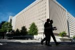 People walk past the World Bank Group's headquarters in Washington, D.C., on May 3, 2013. (Brendan Smialowski/AFP/Getty Images)