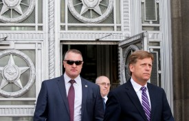 Then-U.S. Ambassador to Russia Michael McFaul, right, leaves the Russian Foreign Ministry headquarters in Moscow on May 15, 2013. (AFP/Getty Images)