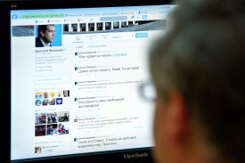 A man looks at the computer screen with the page of Russian Prime Minister Dmitry Medvedev on Twitter in Moscow on August 14, 2014. (Yuri Kadobnov/AFP/Getty Images)