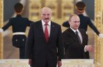 Russian President Vladimir Putin, right, and his Belarusian counterpart Alexander Lukashenko walk in as they attend a session of the Supreme State Council of the Union State at the Kremlin in Moscow on March 3, 2015.  (Sergei Karpukhin/AFP/Getty)