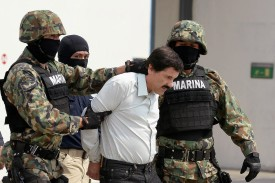 Mexican drug trafficker Joaquín Guzmán Loera is escorted by marines as he is presented to the press on February 22, 2014, in Mexico City. (Alfredo Estrella/AFP/Getty Images)