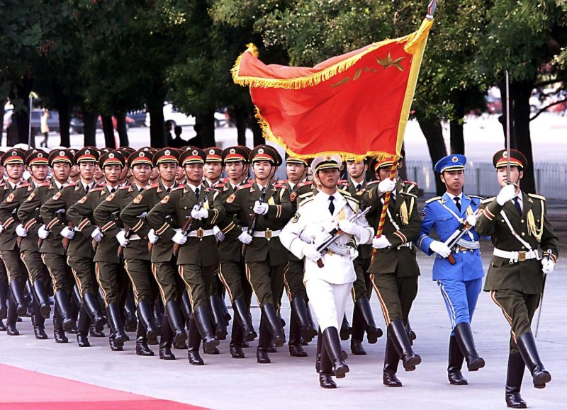 A Chinese People's Liberation Army guard of honor marches during a ceremony on Tiananmen Square in Beijing on June, 26, 2000.