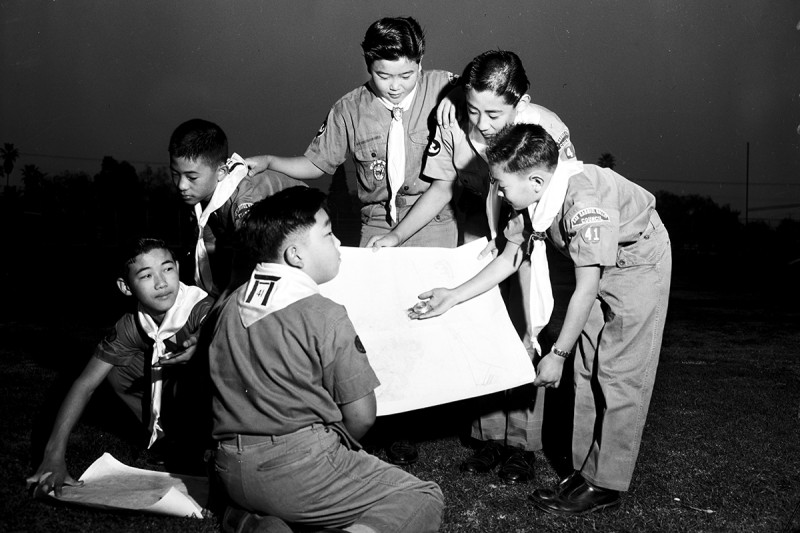 Nisei Boy Scouts of Troop 41 in Pasadena, California, check maps using compasses as part of a mapmaking project in 1958. (University of Southern California Libraries/Corbis via Getty Images)