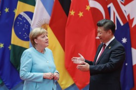 Chinese President Xi Jinping speaks with German Chancellor Angela Merkel at the G-20 summit in Hangzhou, China, on Sept. 4, 2016. (Lintao Zhang/Getty Images)