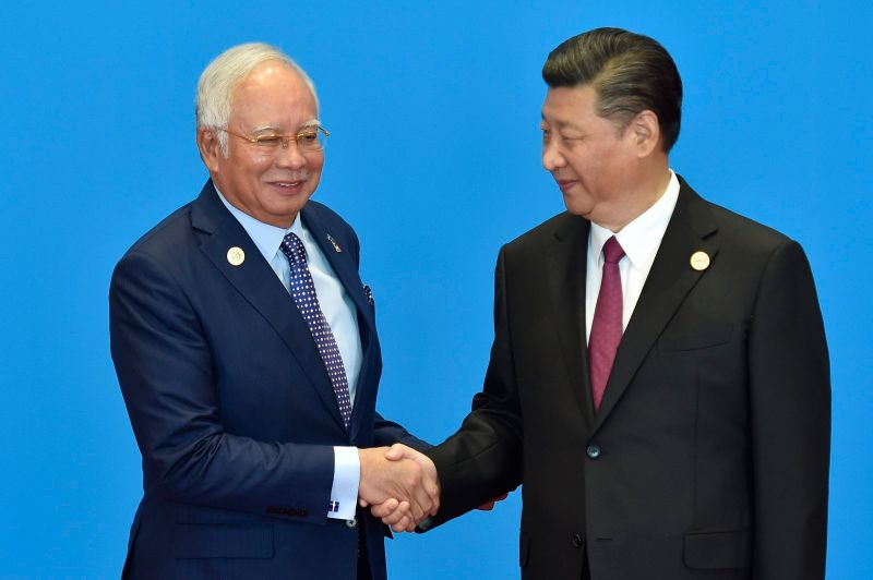Malaysian Prime Minister Najib Razak (left) shakes hands with Chinese President Xi Jinping during the welcome ceremony for the Belt and Road Forum in Beijing on May 15, 2017. (Kenzaburo Fukuhara-Pool/Getty Images)