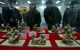 People view erotic sculptures during the first Xian Sex Culture Festival on December 30, 2007 in Xian of Shaanxi Province, China. (Photo by China Photos/Getty Images)