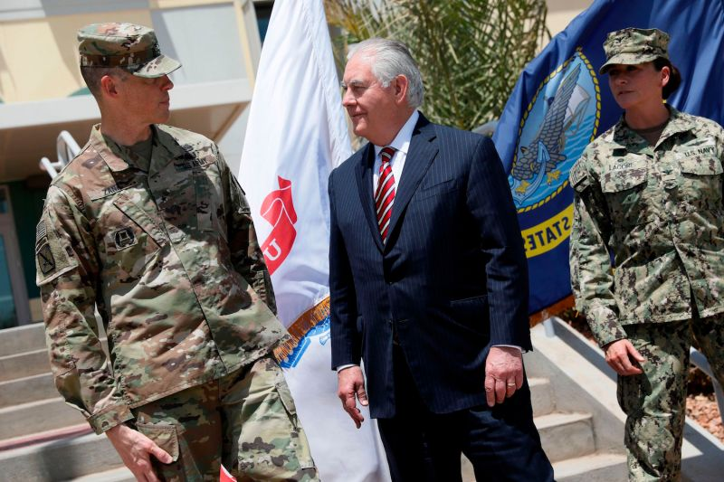U.S. Army Brig. Gen. William Zana, left, greets then-U.S. Secretary of State Rex Tillerson at Camp Lemonnier, Djibouti, on March 9, 2018. (Jonathan Ernst/AFP/Getty Images)