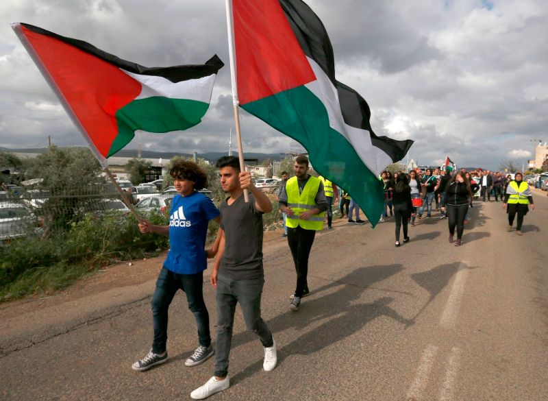 Arab-Israelis—also known as Palestinian citizens in Israel—wave Palestinian flags at a Land Day demonstration in the village of Araba in the Galilee on March 30, 2018. (Jalaa Marey/AFP/Getty Images)